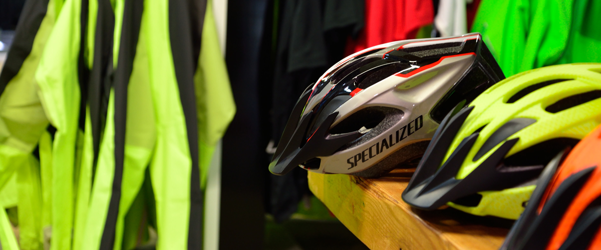 Inside a bike shop with hi viz jackets and helmet