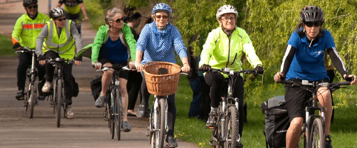 A group of older cyclists riding together