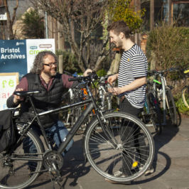 Loan bike employee showing customer how to set up the bike