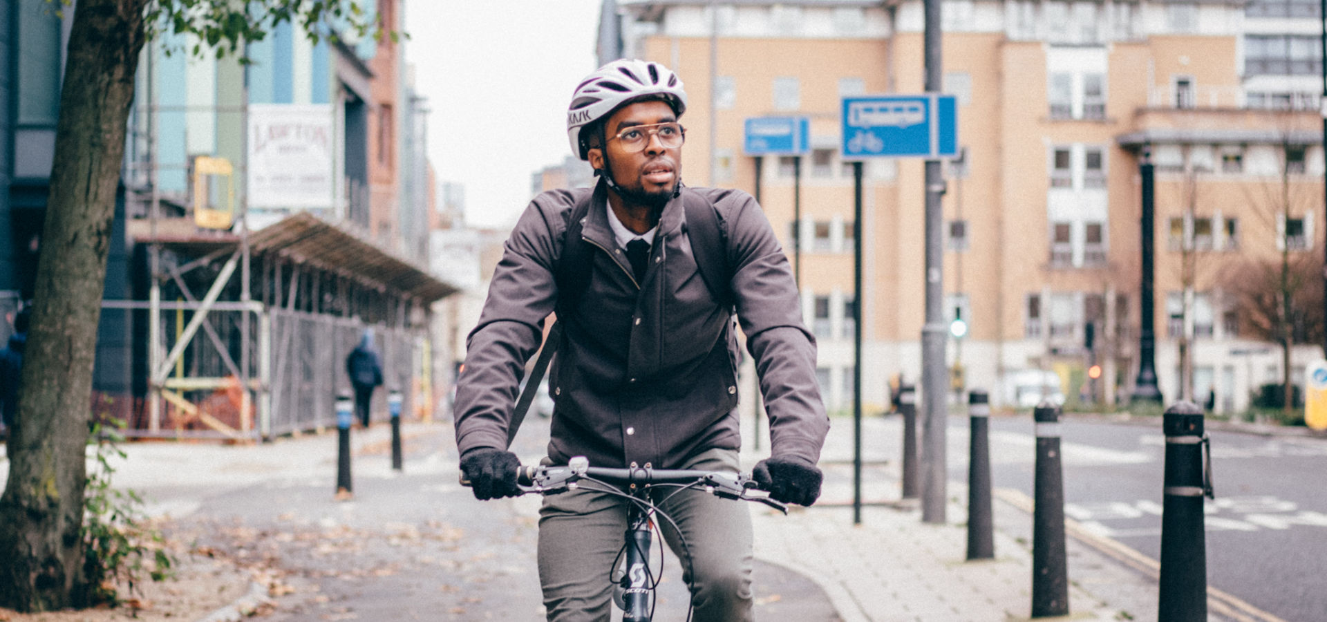 Man cycling in Bristol on segregated cycle way