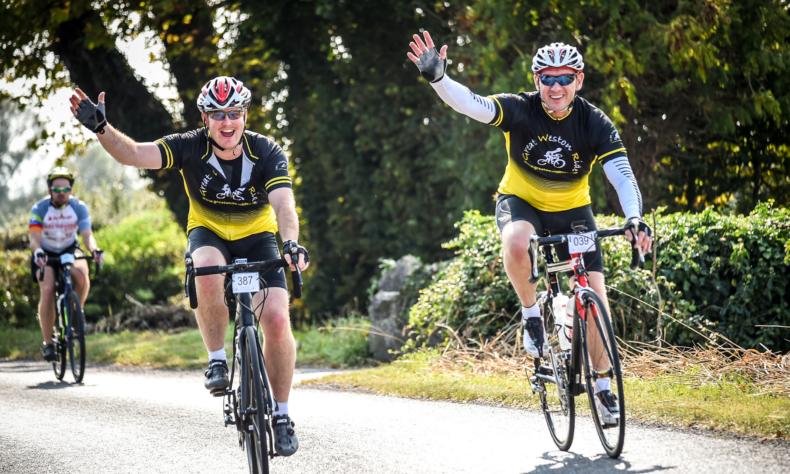 Two men rising a bike taking part in Great Weston Ride header image